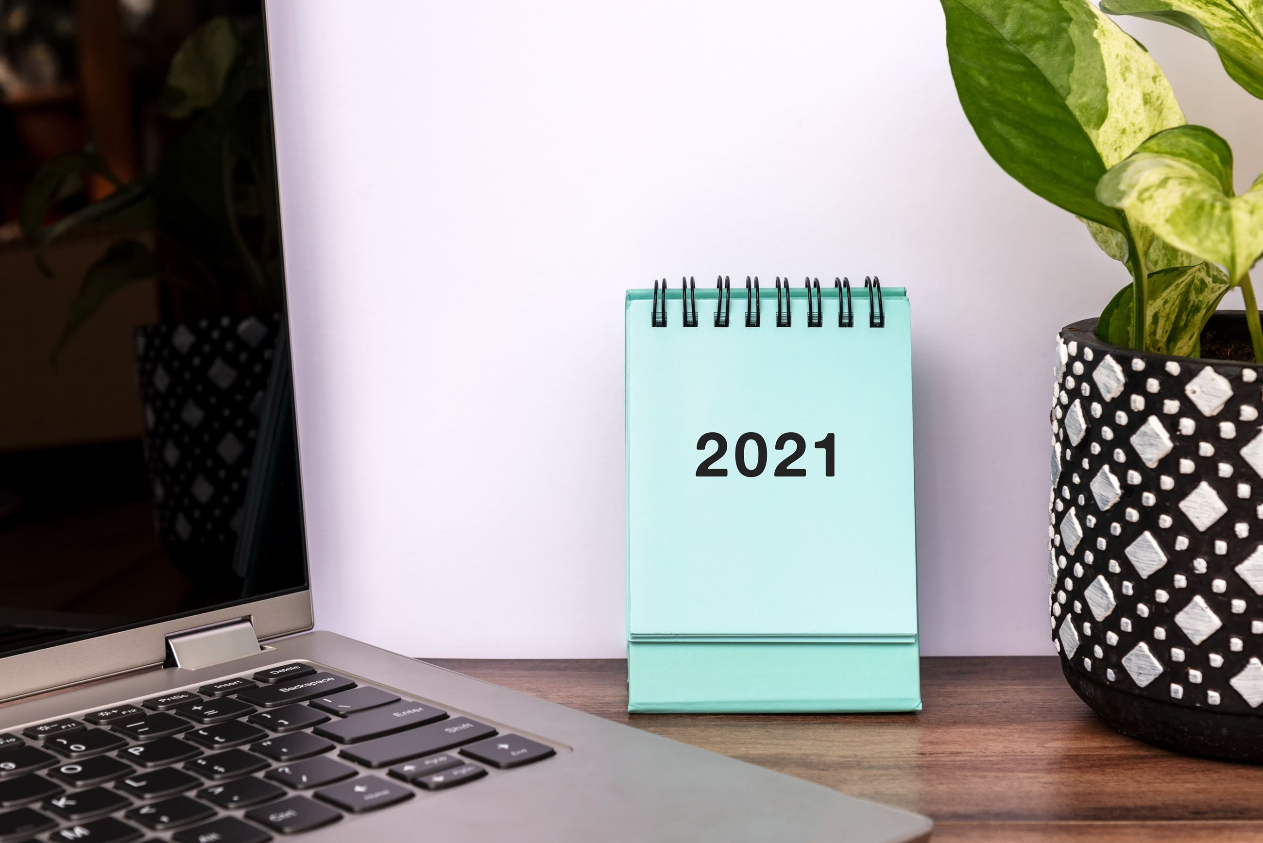 January 2021 teal calendar on desk