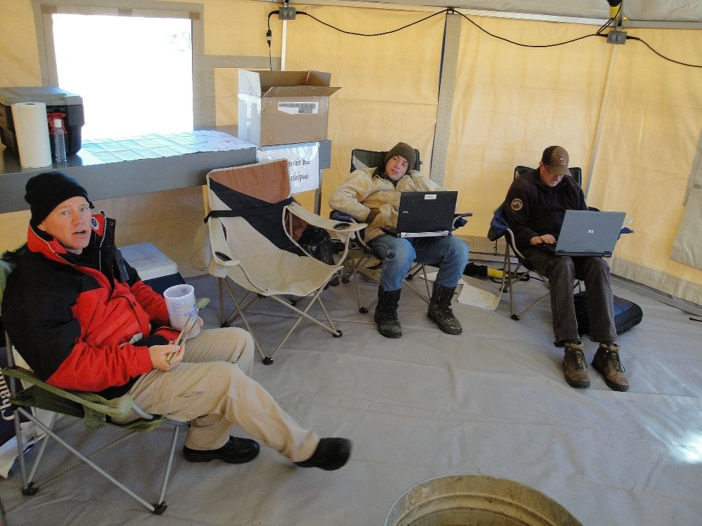 DWR staff and volunteers relax in between fisherman check ins.