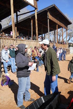 Photo of TV Outdoor personality Adam Eakle interviewing a 2011 Burbot Bash participant