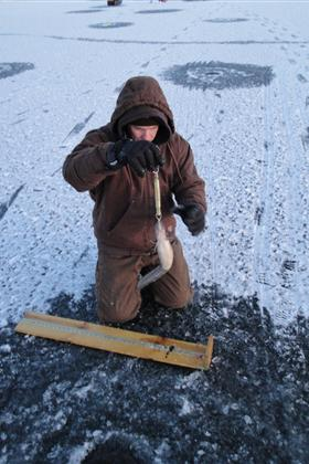 DWR Staff person measures a burbot before tagging it and releasing it in preparation for the 2011 Burbot Bash.