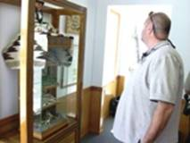 Man looking at museum display